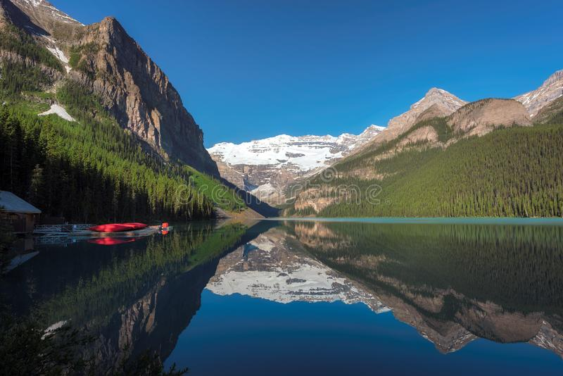 Llake Louise in Canadian Rockies, Banff National Park, Canada. Beautiful turquoise waters of the Lake Louise with snow-covered peaks above it in Rocky Mountains royalty free stock photography