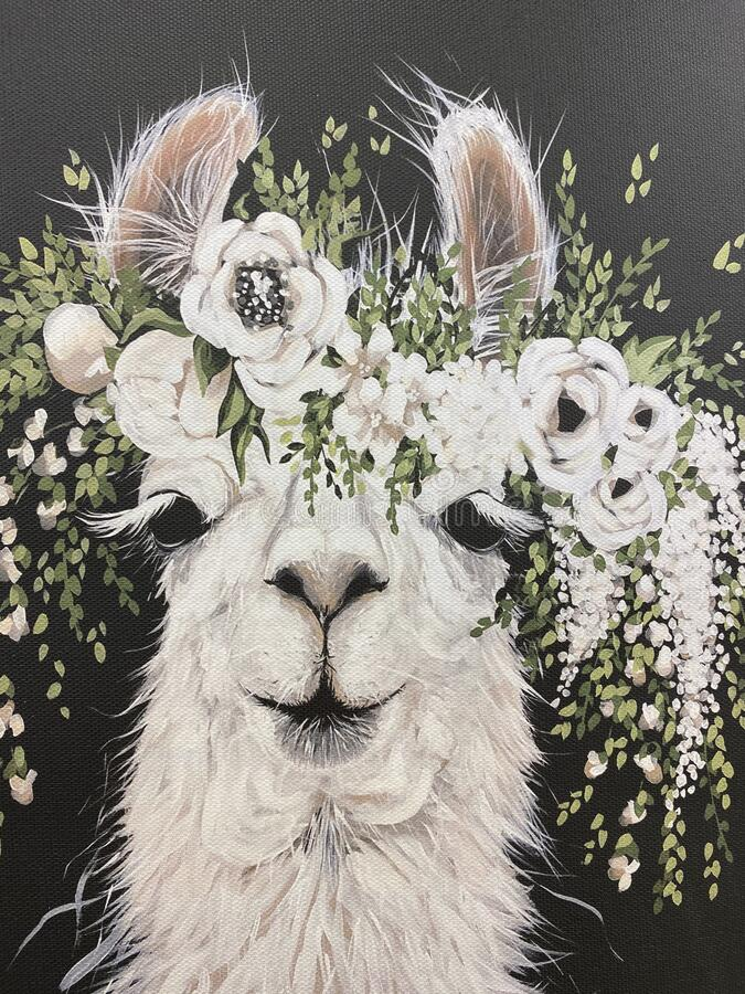 Llama alpaca with flowers on dark background stock image