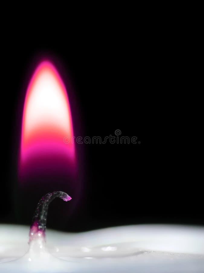 Llama de vela púrpura imágenes de archivo libres de regalías