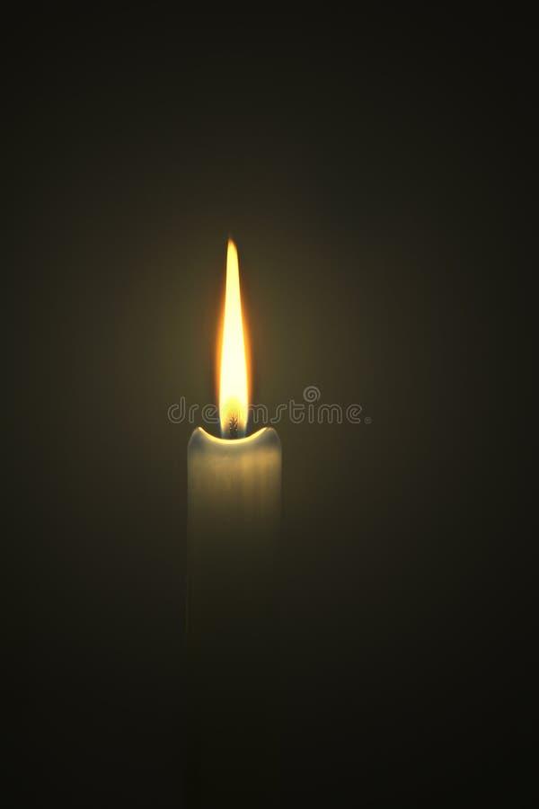 Llama ligera de la vela foto de archivo libre de regalías