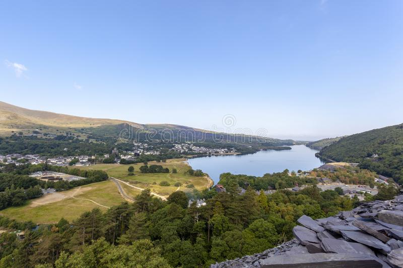 Llanberis and Llyn Padarn View. A view of Llyn Padarn and Llanberis from the old slate tips of Dinorwic Quarry royalty free stock photos
