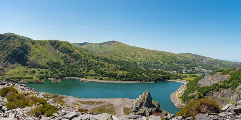 Llanberis and Llyn Peris, seen from Dinorwic Quarry, Gwynedd, Wales, UK. View from Dinorwic Quarry, Gwynedd, Wales, UK - with Llyn Peris, the Dinorwig Power stock photo