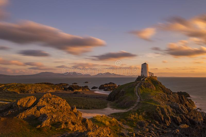 Llanddwyn Island Lighthouse, Anglesey , north Wales. Tŵr Mawr lighthouse meaning `great tower` in Welsh, on Ynys Llanddwyn on Anglesey, Wales, marks the stock photography