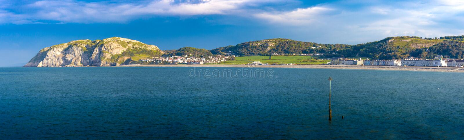 Llandudno bay. Llandudno north wales UK. Picture of the little Orme taken from Llandudno pier royalty free stock photography
