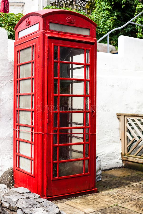 LLandudno, Wales, UK - MAY 27, 2018 An old classic British red phone booth. Traditional red phone box on street. Not working vinta. An old classic British red stock photo