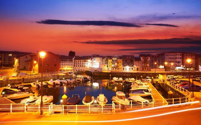 Llanes marina port sunset in Asturias Spain. Llanes marina port sunset in Asturias of Spain royalty free stock image