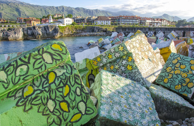 Llanes painted cubes. Painted cubes on port of Llanes, Asturias, Spain stock images