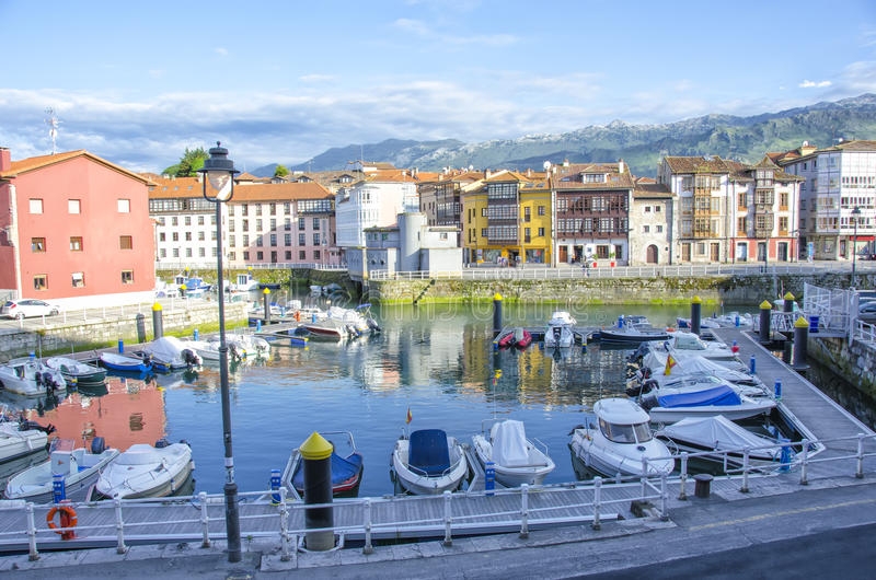 Llanes port. With the bottom Picos de Europa royalty free stock photography
