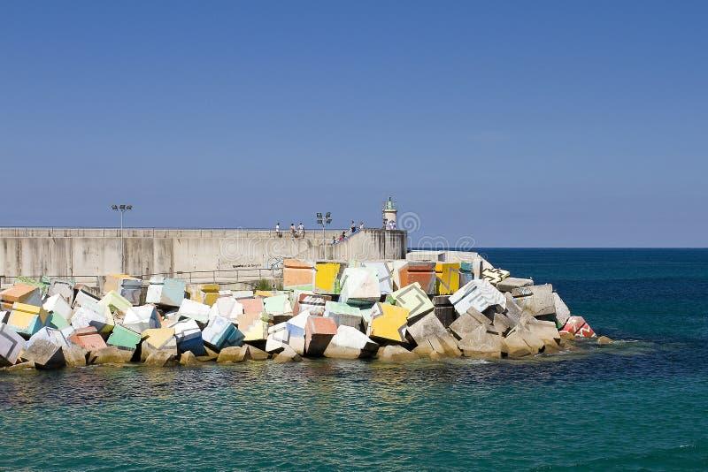 Llanes, Spain. Los Cubos de la Memoria, sculpture by Agustin Ibarrola in the seaport, Llanes. Asturias, Spain stock photography