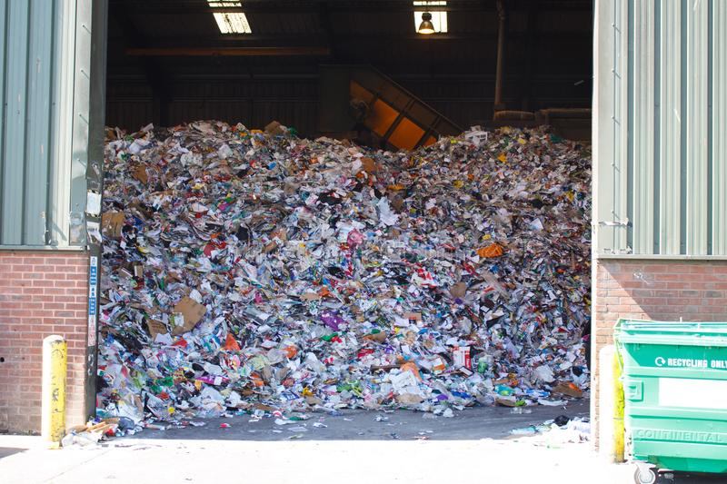 Llarge pile of colored paper waste at the waste recycling plant royalty free stock photography