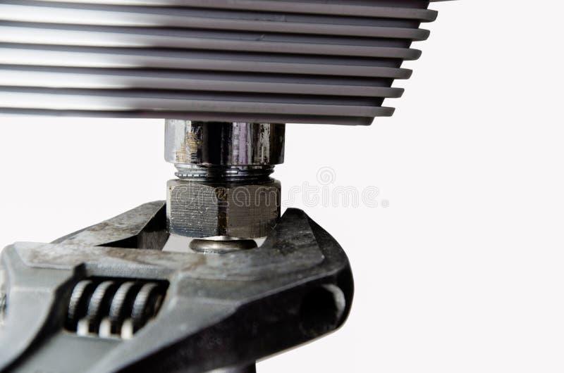 Llave ajustable, reparación, abastecimiento de agua fotos de archivo libres de regalías
