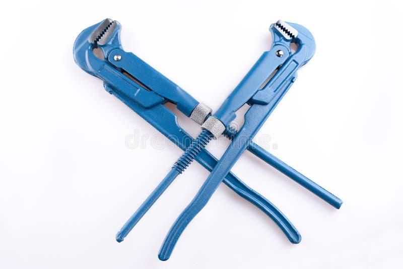 Llave de tubo ajustable, alicates, llave inglesa o herramienta el sondear en el fondo blanco imágenes de archivo libres de regalías