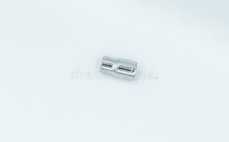 Llave de z?calo de plata en un estudio blanco imagen de archivo