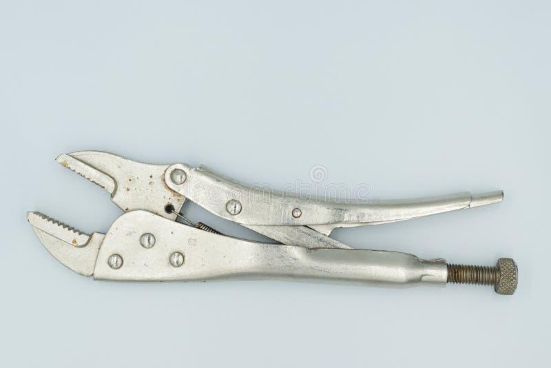 Llave de z?calo de plata en un estudio blanco foto de archivo libre de regalías
