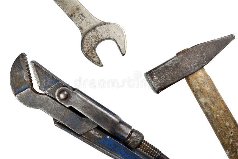 Llave inglesa ajustable, martillo y llave viejos foto de archivo libre de regalías