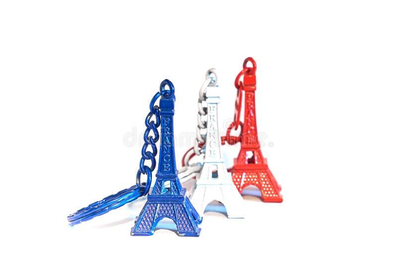 Llaveros del recuerdo de la torre Eiffel en colores de la bandera de Francia fotografía de archivo