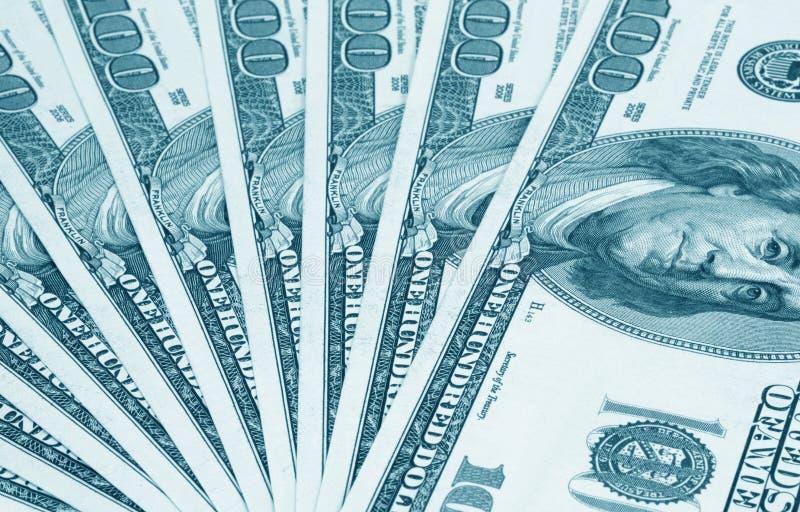 Lle banconote dei cento dollari. L'azzurro ha modificato fotografia stock libera da diritti