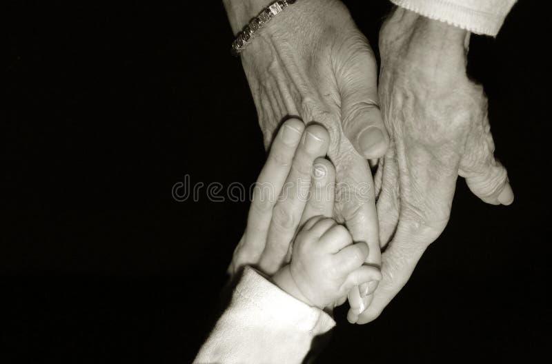Lle mani di quattro generazioni immagini stock