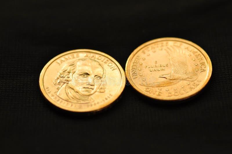 Lle monete di un dollaro fotografia stock libera da diritti