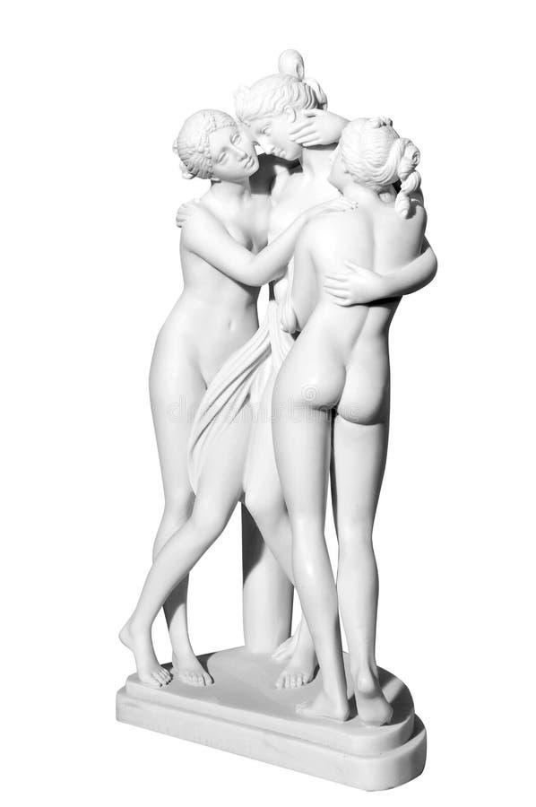 Lle statue di tre ragazze nude fotografie stock