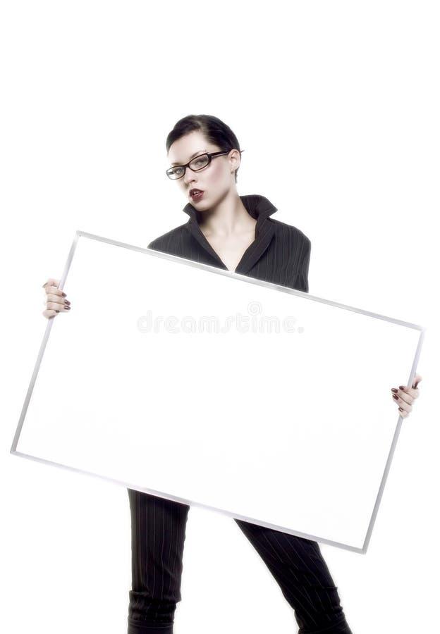 Llevar a cabo a la tarjeta en blanco fotografía de archivo