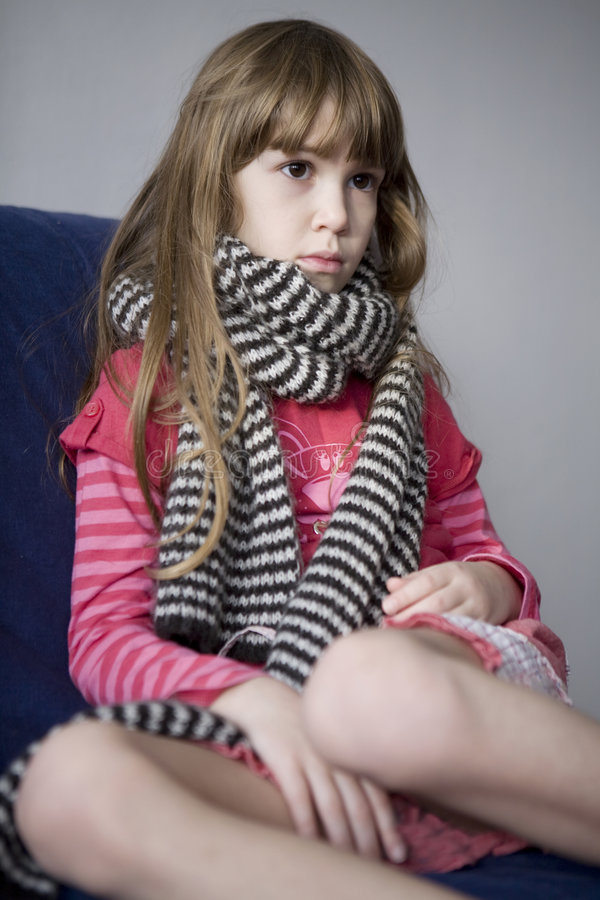 Llittle cute sick girl with scarf. Sore throat stock photos