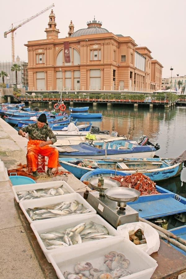 Local fisherman on Bari promenade royalty free stock images