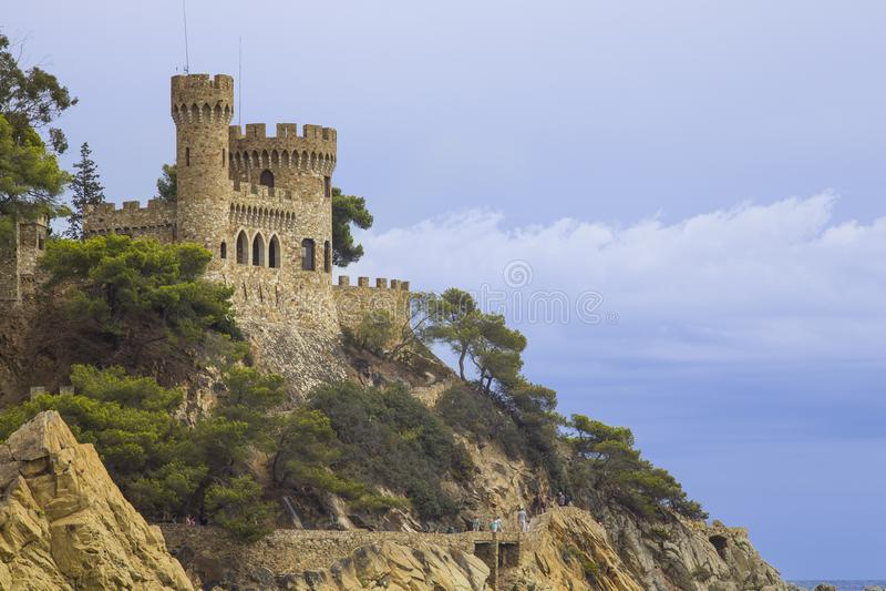 Beautiful city beach under the castle on the coast of Lloret de Mar royalty free stock photo