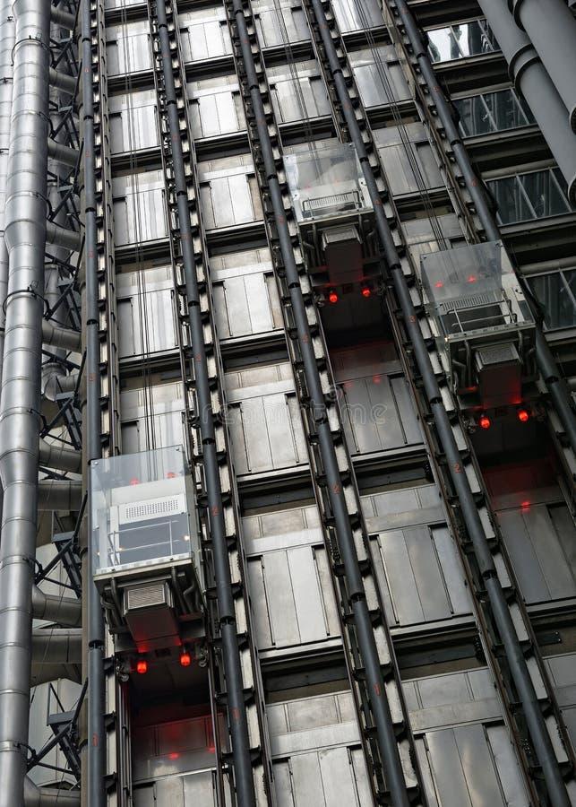 Lloyds Building Elevators, Лондон, Великобритания стоковые изображения rf