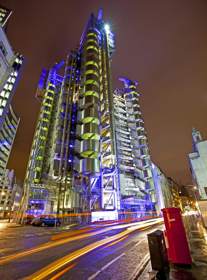 Lloyds of London. LONDON, ENGLAND FEB 13: Famous abstract Lloyds of London building at night on Feb 13, 2012 in London, United Kingdom royalty free stock photography