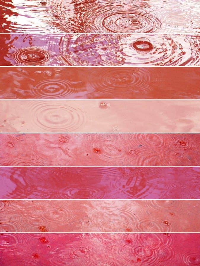 Llueva las banderas de la gota en tonos rojos y rosados imagen de archivo