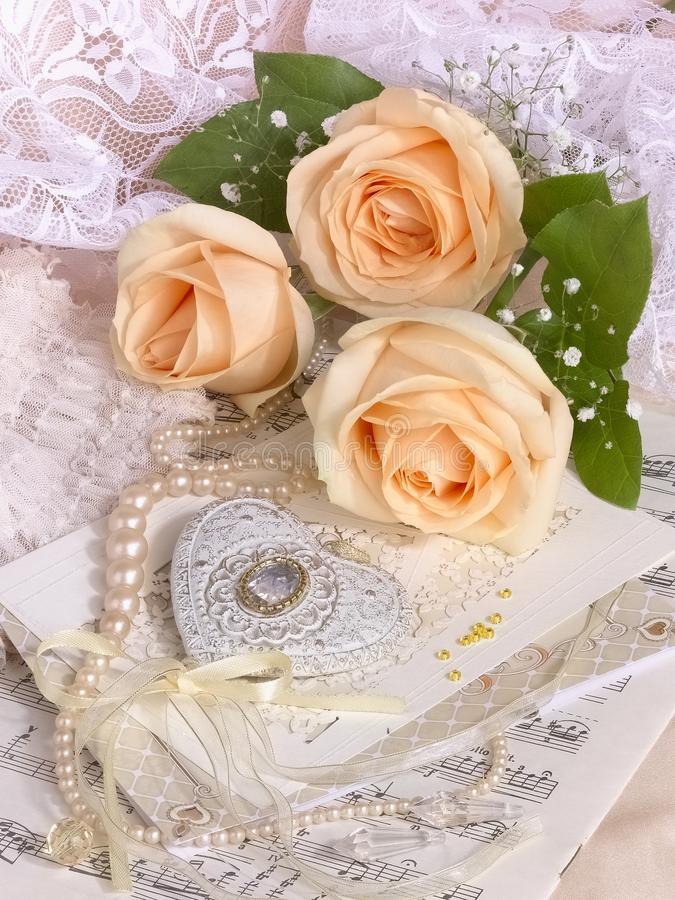 Wedding image with tea roses and pearl necklace stock photos