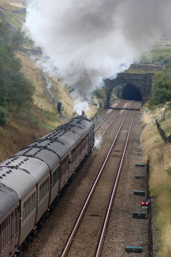 Dalesman steam train approaching Blea Moor Tunnel. LMS Royal Scot class preserved steam locomotive Scots Guardsman, number 46115, approaching Blea Moor tunnel on royalty free stock image