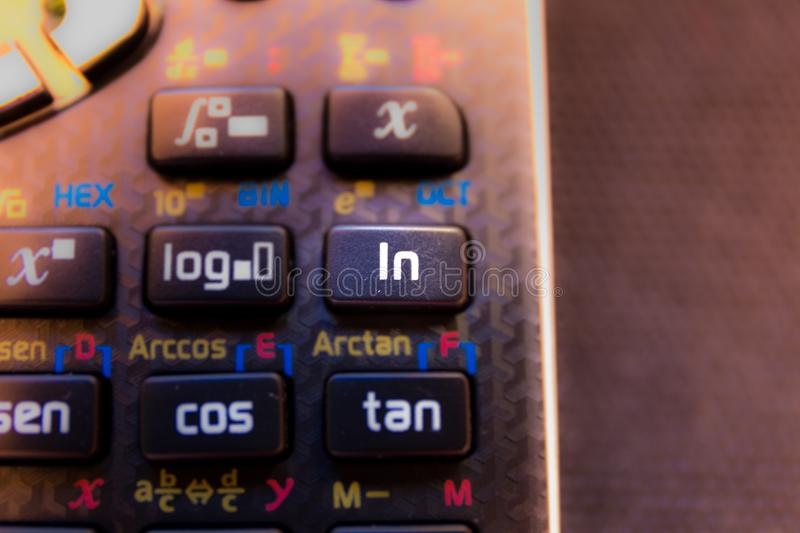 Ln Neperian logarithm key of a scientific calculator keyboard. Machine stock photography