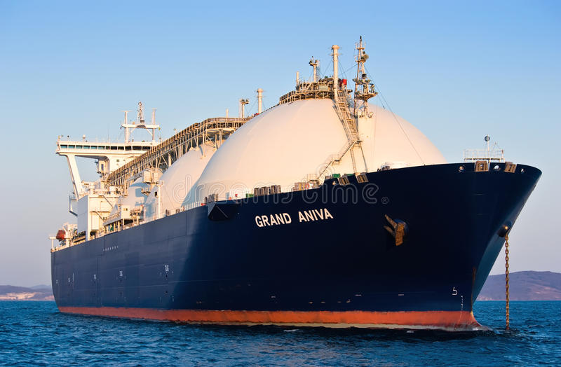 LNG carrier Grand Aniva at sunset on the roads of the port of Nakhodka. Far East of Russia. East (Japan) Sea. 31.03.2014 stock image
