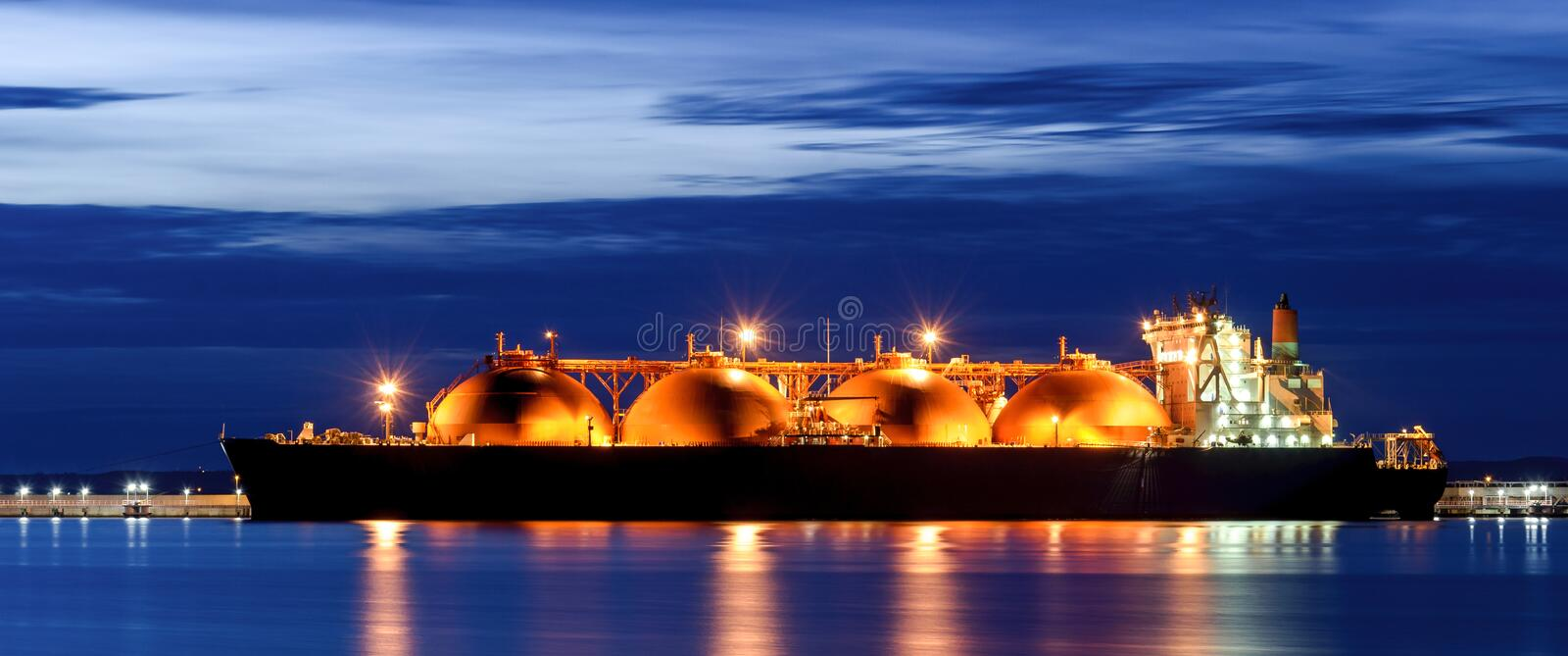 LNG TANKER AT THE GAS TERMINAL royalty free stock photo