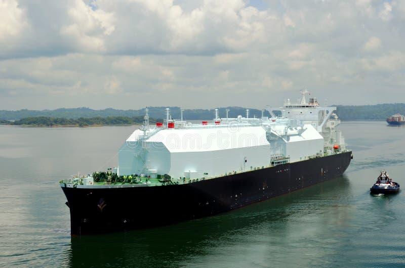 LNG tanker ship transiting through Panama Canal. LNG tanker ship sailing on the Gatun Lake during her transit through the Panama Canal on beautiful sunny day stock photos