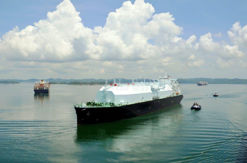LNG tanker ship transiting through Panama Canal. LNG tanker ship sailing on the Gatun Lake during her transit through the Panama Canal on beautiful sunny day royalty free stock image