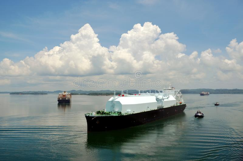 LNG tanker ship transiting through Panama Canal. LNG tanker ship sailing on the Gatun Lake during her transit through the Panama Canal on beautiful sunny day stock image
