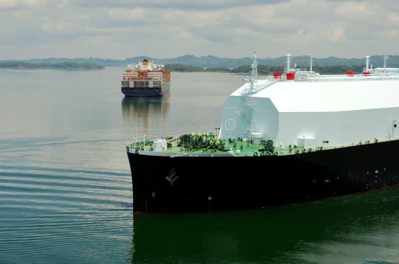LNG tanker ship transiting through Panama Canal. LNG tanker ship sailing on the Gatun Lake during her transit through the Panama Canal on beautiful sunny day royalty free stock photo