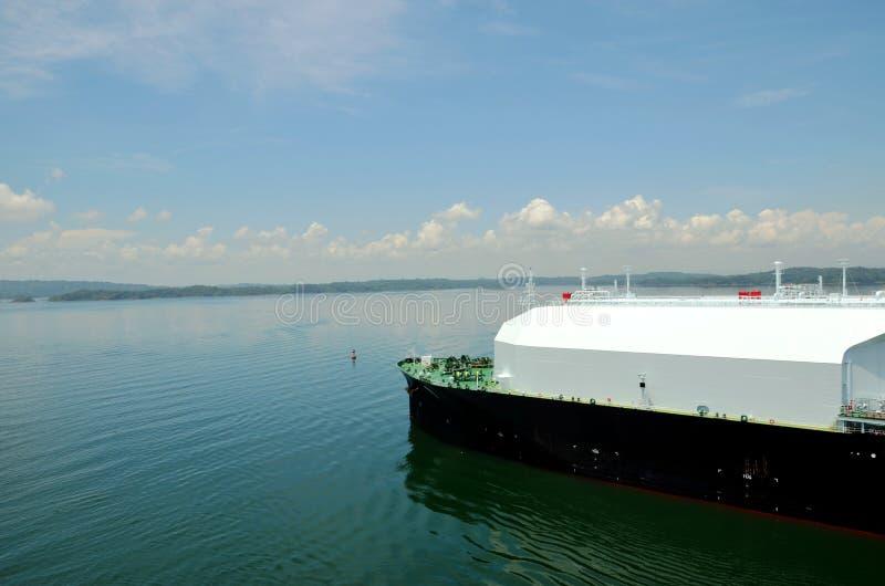 LNG tanker ship transiting through Panama Canal. LNG tanker ship sailing on the Gatun Lake during her transit through the Panama Canal on beautiful sunny day stock images