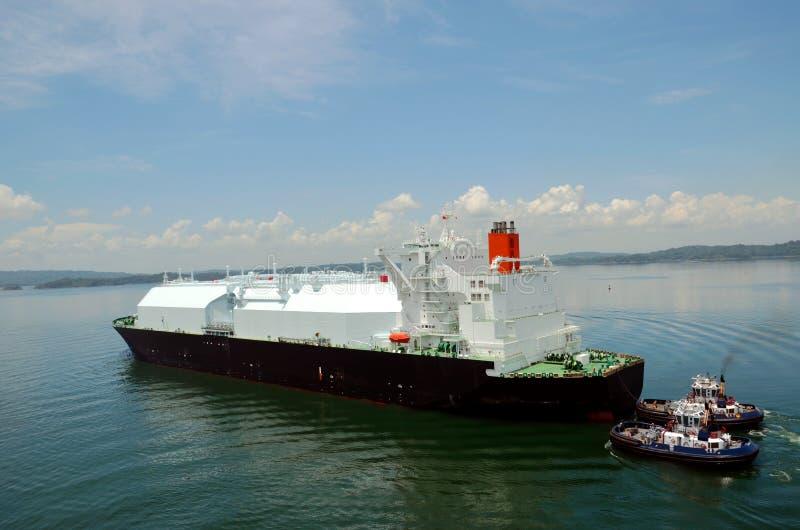 LNG tanker ship transiting through Panama Canal. LNG tanker ship sailing on the Gatun Lake during her transit through the Panama Canal on beautiful sunny day stock photo
