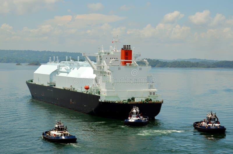 LNG tanker ship transiting through Panama Canal. LNG tanker ship sailing on the Gatun Lake during her transit through the Panama Canal on beautiful sunny day royalty free stock images