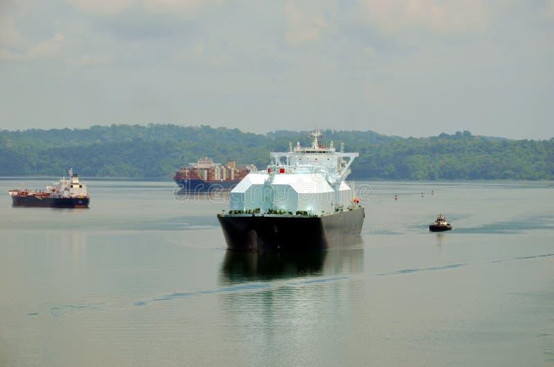 LNG tanker ship transiting through Panama Canal. LNG tanker ship transiting through Panama Canal on beautiful sunny day stock photo