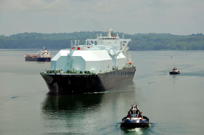 LNG tanker ship transiting through Panama Canal. LNG tanker ship transiting through Panama Canal on beautiful sunny day stock images