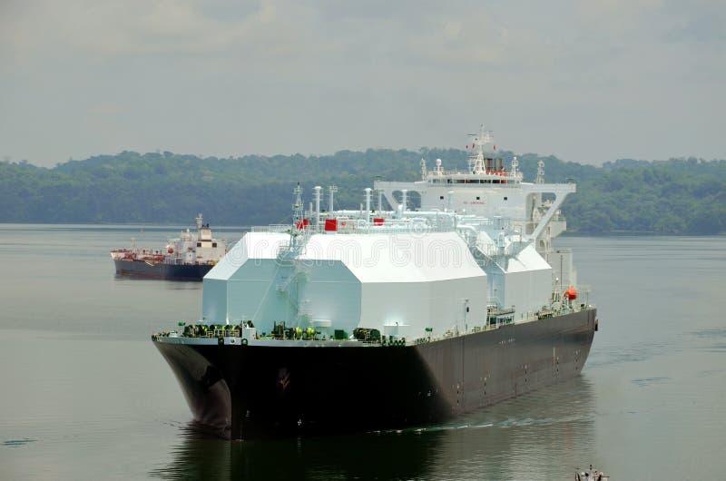 LNG tanker ship transiting through Panama Canal. LNG tanker ship transiting through Panama Canal on beautiful sunny day royalty free stock image