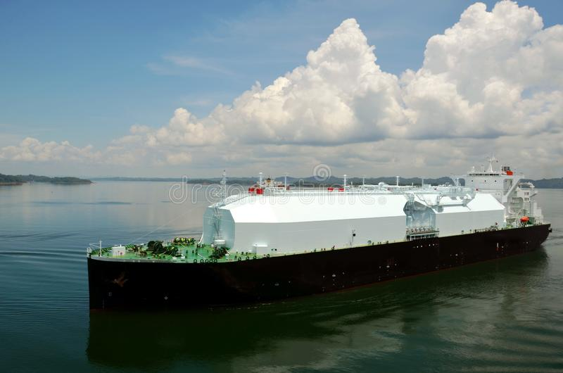 LNG tanker ship transiting through Panama Canal. LNG tanker ship sailing on the Gatun Lake during her transit through the Panama Canal on beautiful sunny day stock photography