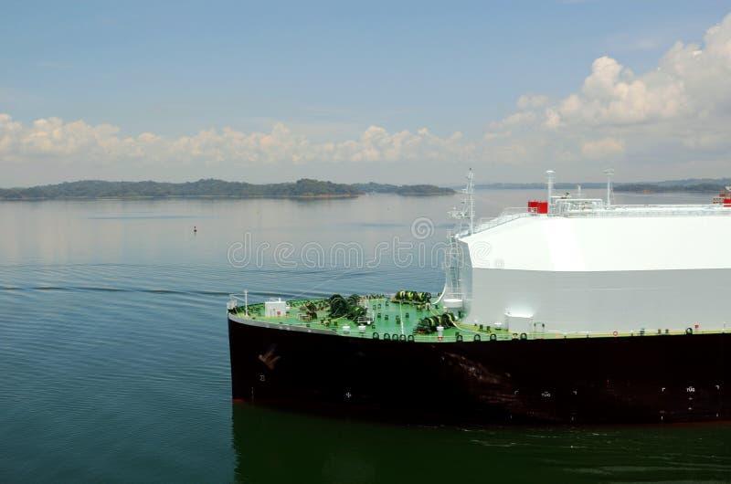 LNG tanker ship transiting through Panama Canal. LNG tanker ship sailing on the Gatun Lake during her transit through the Panama Canal on beautiful sunny day royalty free stock photos
