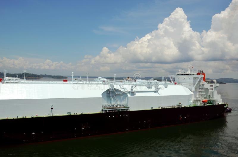 LNG tanker ship transiting through Panama Canal. LNG tanker ship sailing on the Gatun Lake during her transit through the Panama Canal on beautiful sunny day royalty free stock photography