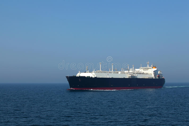 LNG tanker in transit at high seas lit by the sun stock photos